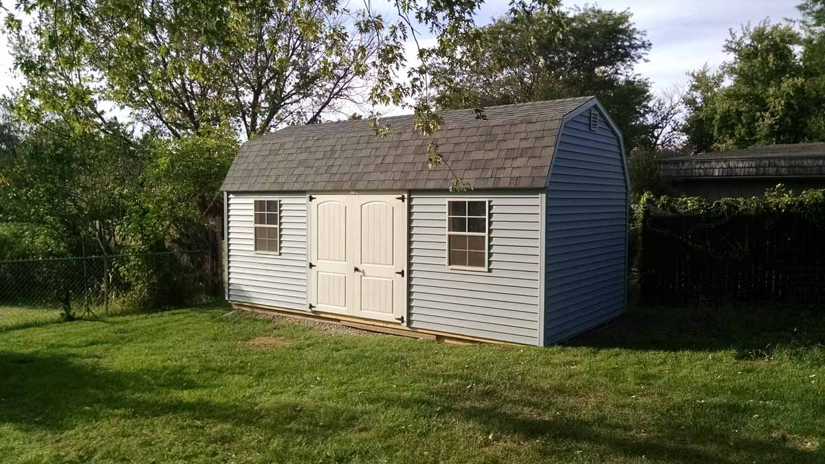 Lofted garden shed with vinyl siding