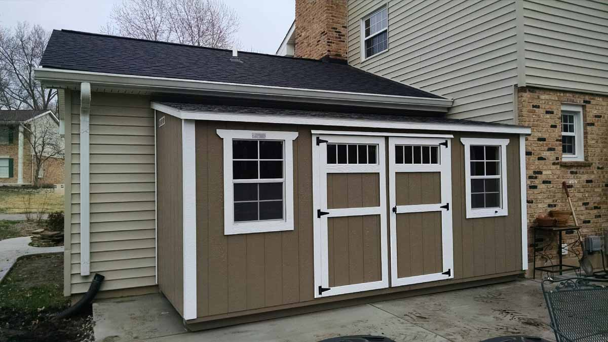 Lean to style shed painted with transom windows in the doors